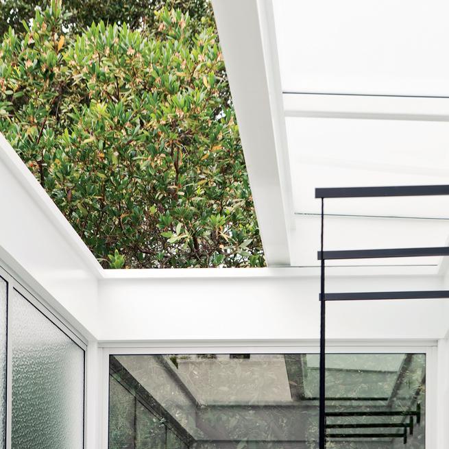 Rollamatic window retractable skylight in dining room
