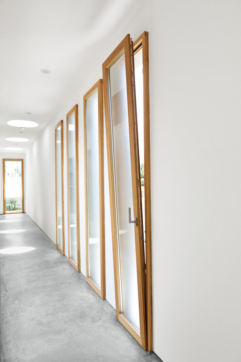 Tilt-turn wood window-doors by hallway