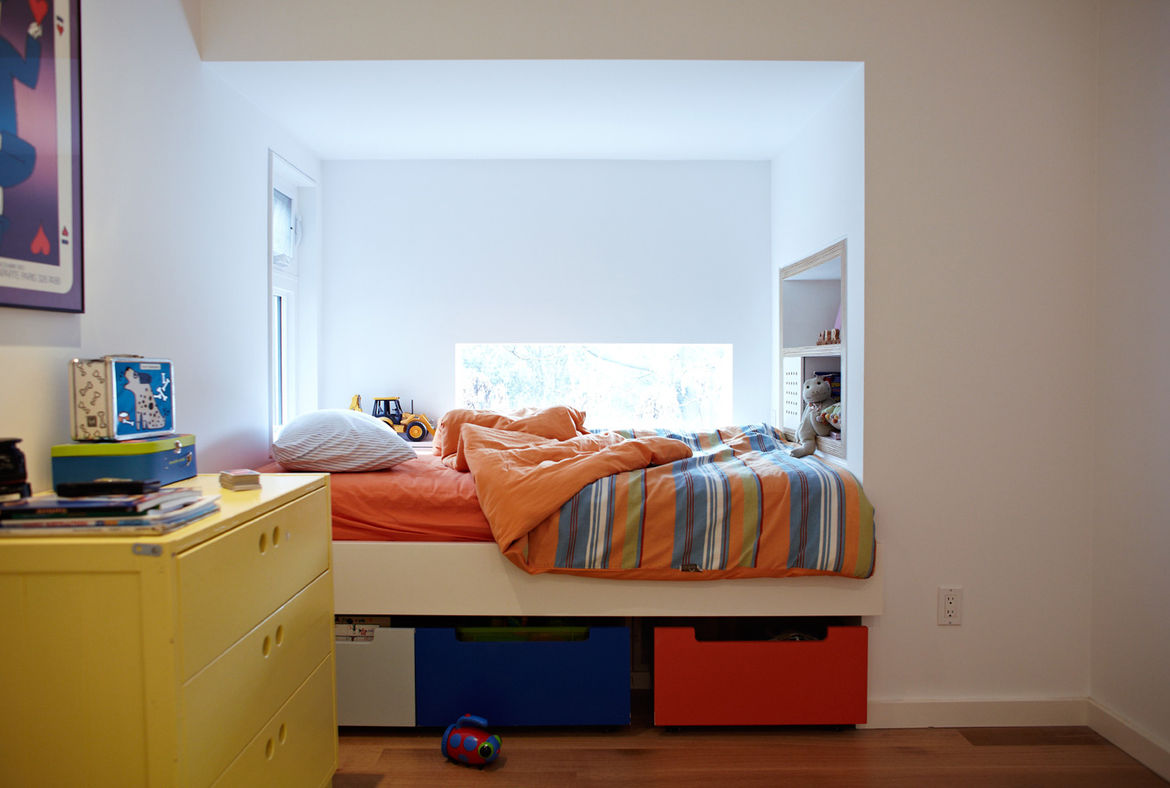 Modern bedroom nook with floor shelving