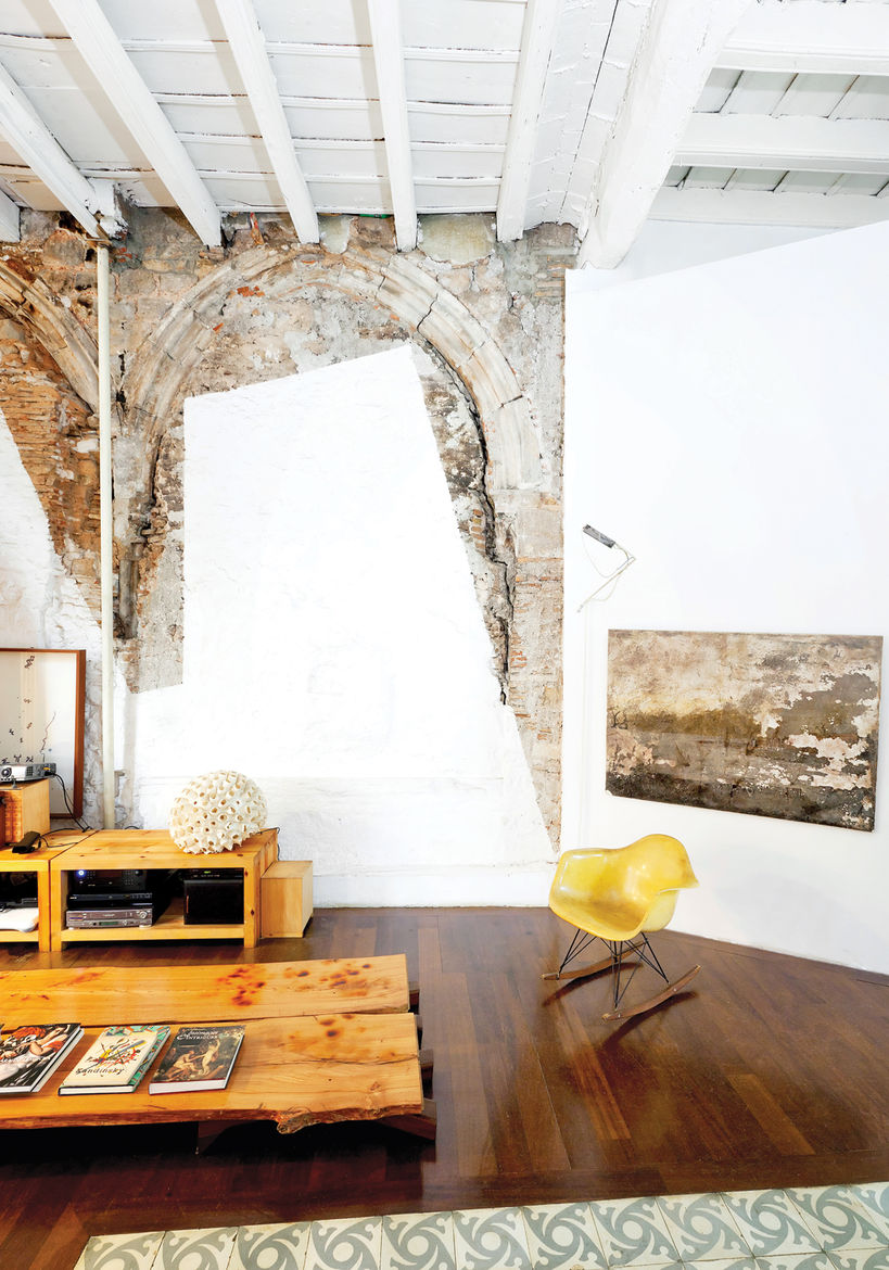 Living room with white plaster walls and yellow Eames chair