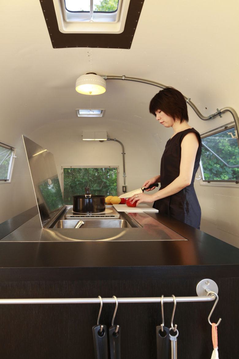 Renovated Airstream trailer kitchen with skylight