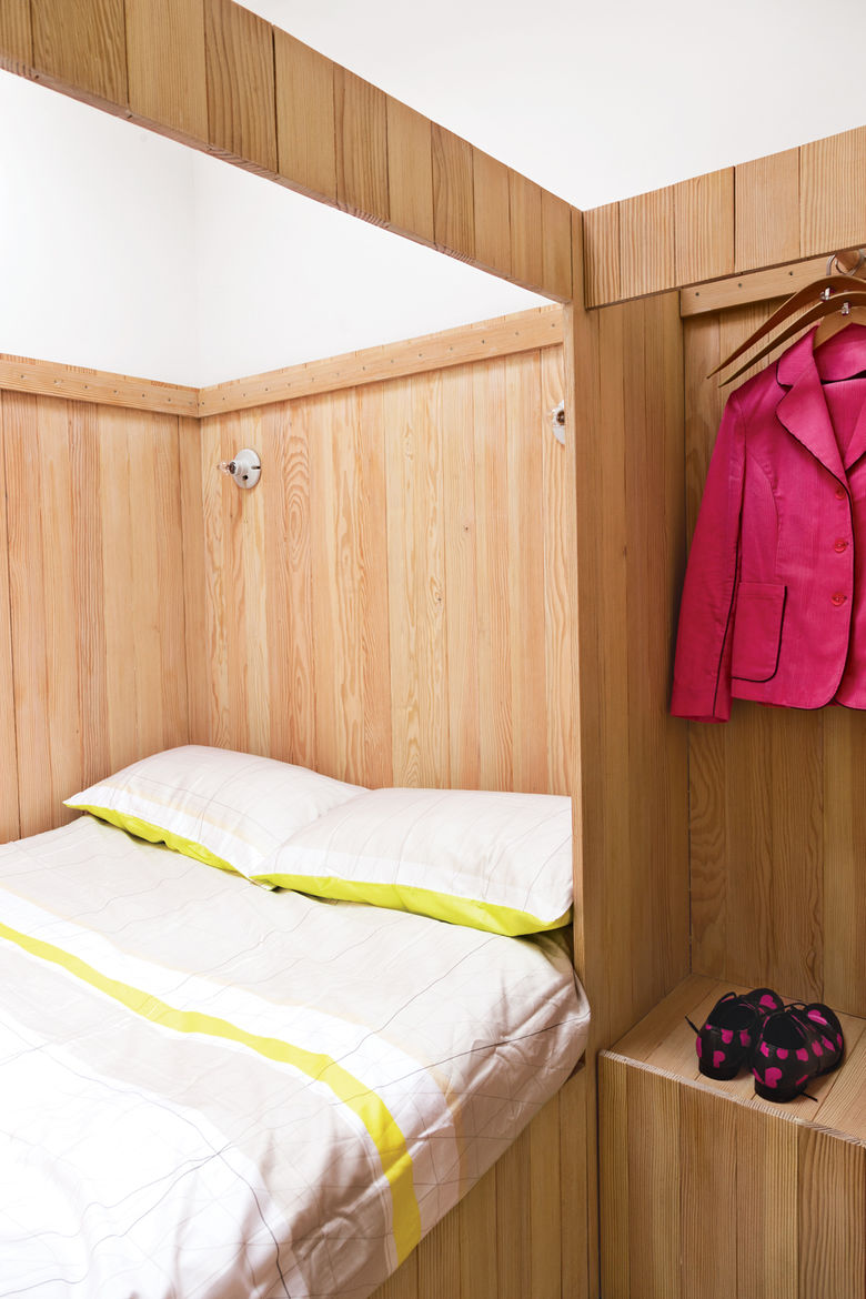Modern bedroom with wood plank walls and Pilot hangers