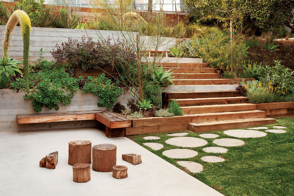 Modern outdoor garden with redwood paneled fence