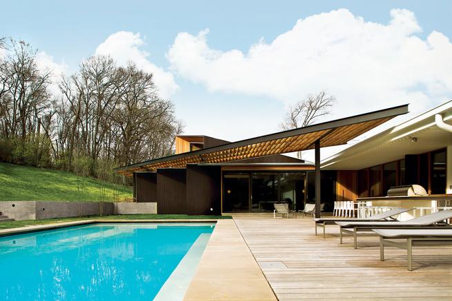 Modern house with ipe pool terrace and Douglas fir trellis