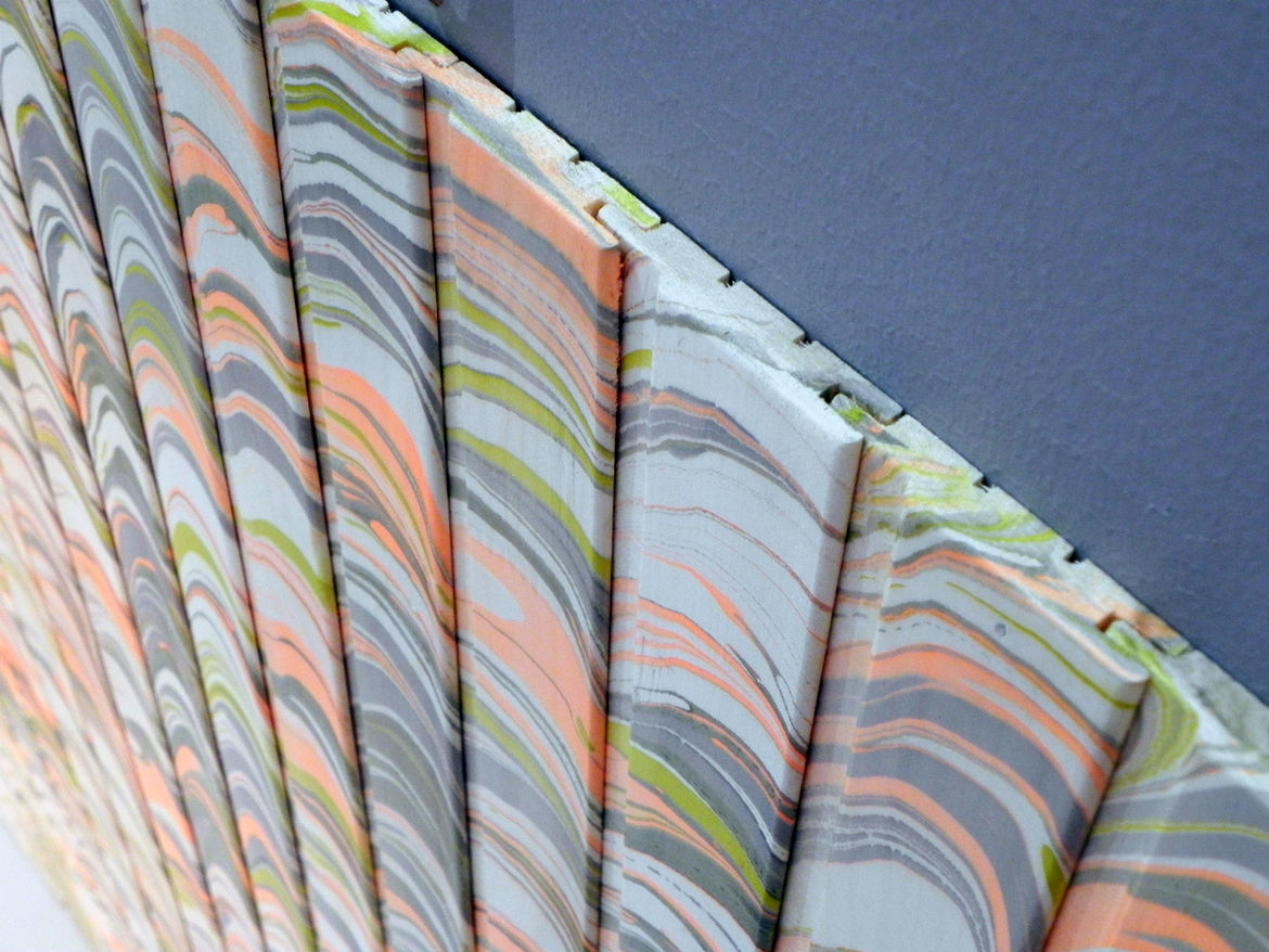 Tongue-and-groove marbled wood panels by Pernille Snedker Hansen