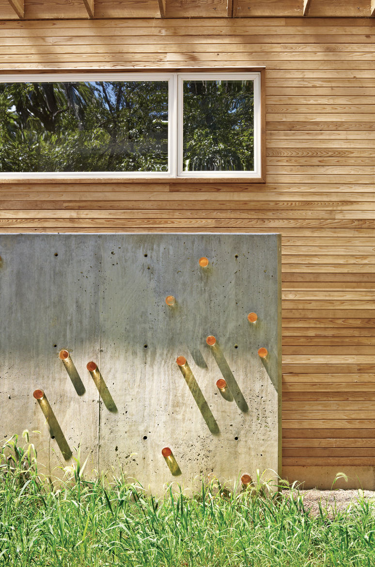 Outdoor concrete wall with acrylic cylinders