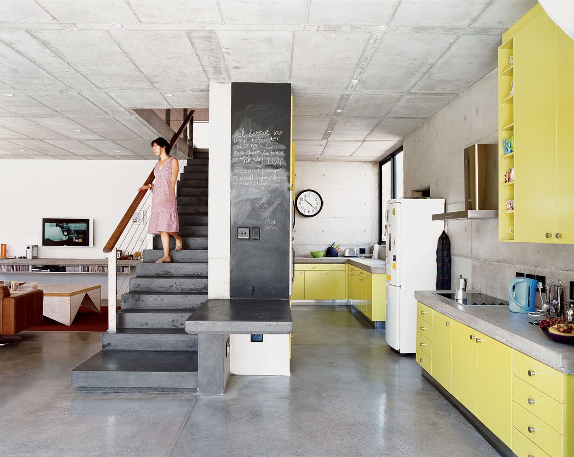 Modern kitchen with freestanding staircase