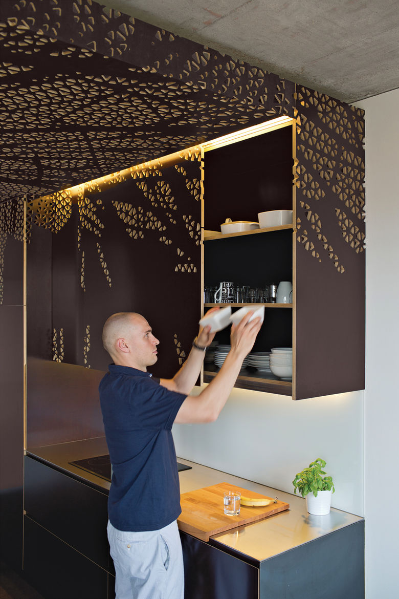 Modern handmade cabinetry with hand-carved patterning