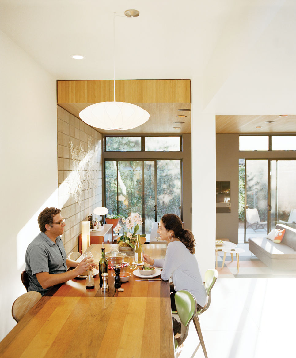 Dining room with 1970s Milo Baughman dining table and Cherner chairs