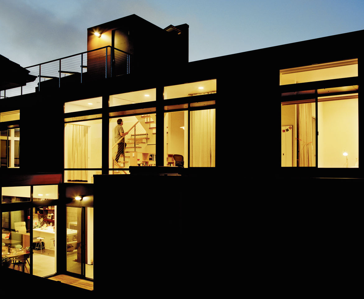 Nighttime view of prefab home facade