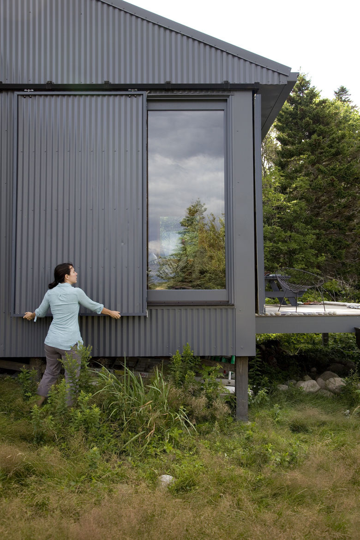 Sliding corrugated metal window panels