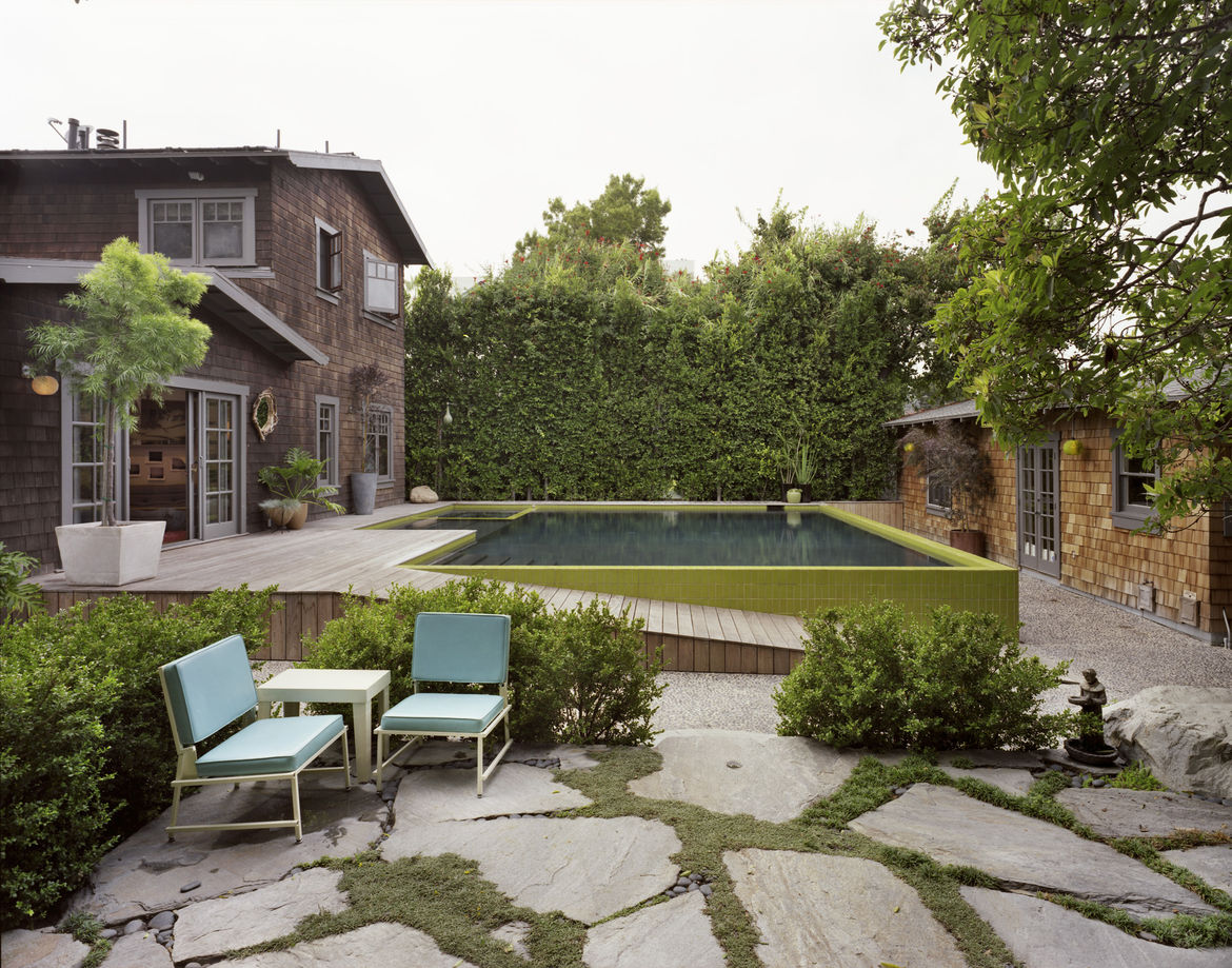 Modern pool house with rock garden