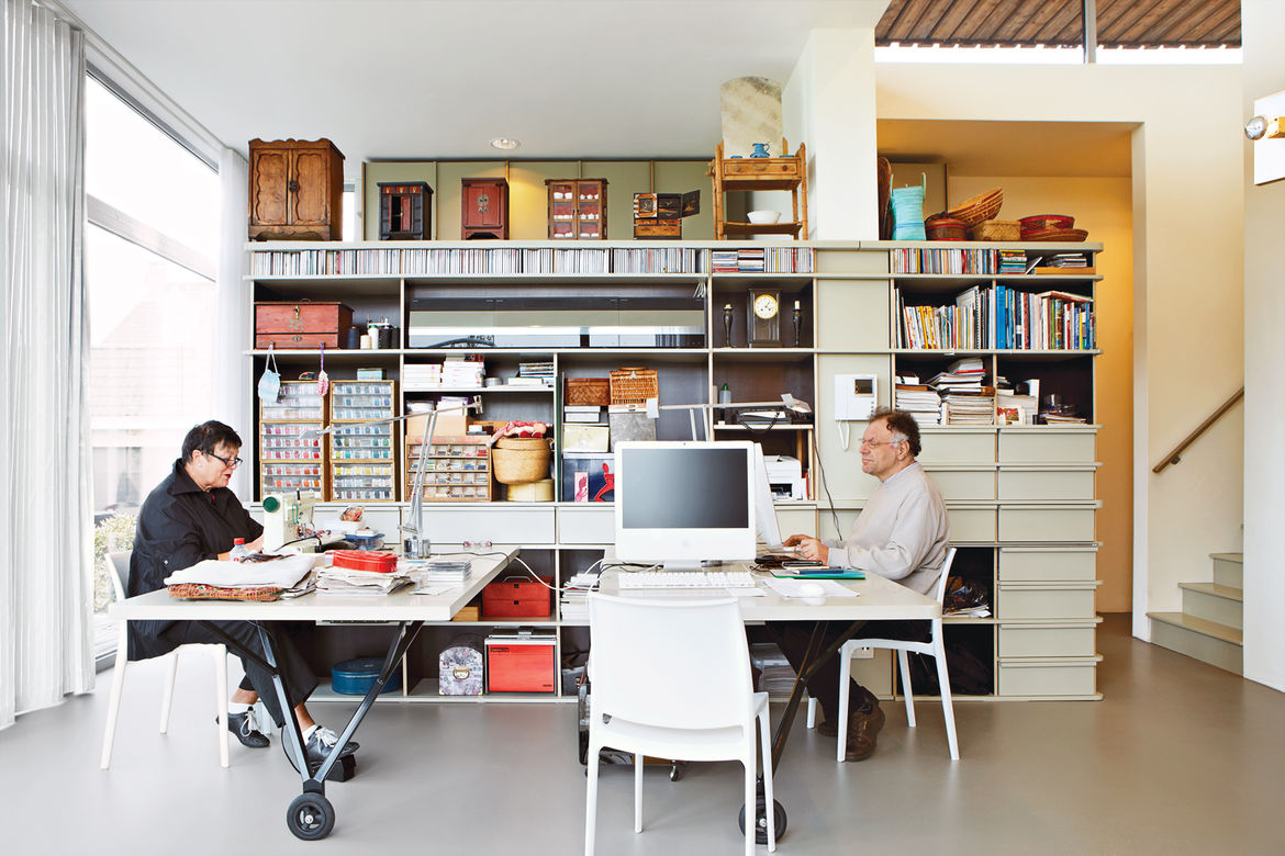 Work space with custom shelving houses