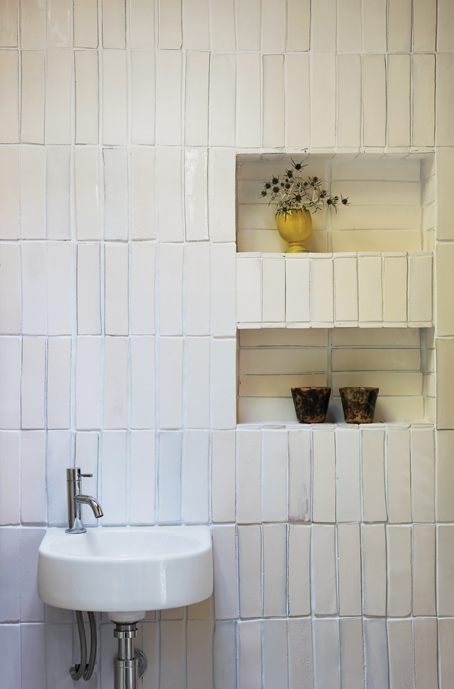 Bathroom with salvaged tile wall
