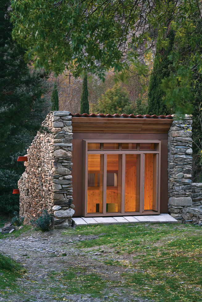 Modern cabin renovation with glass facade