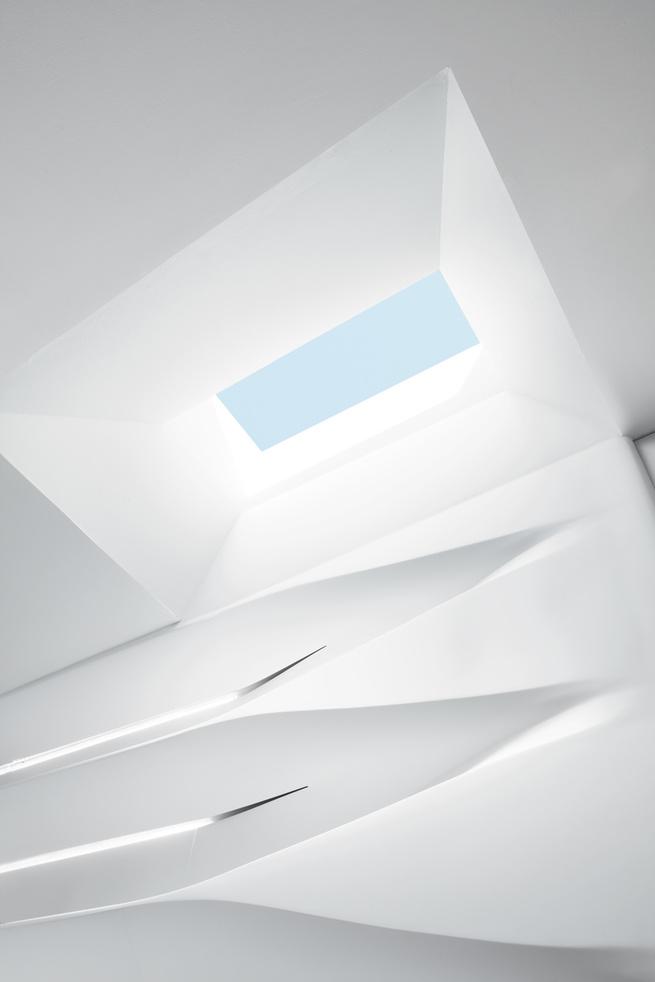 Sculptural wall shelving ceiling renovation