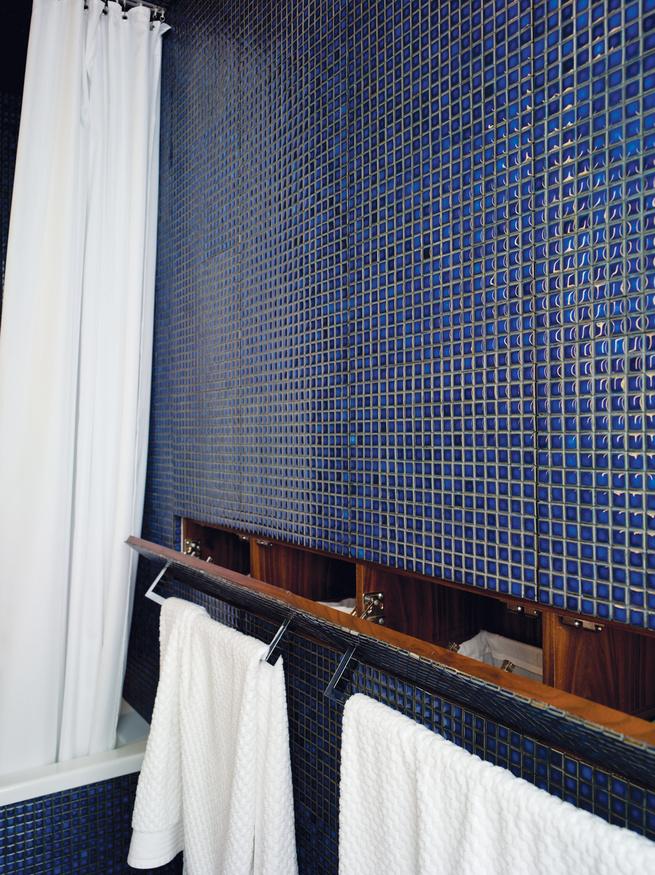 Hidden wall cabinets in bathroom