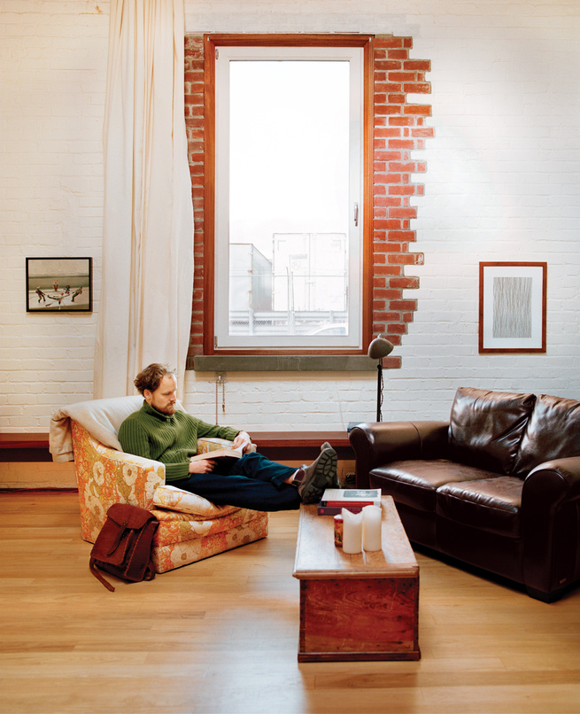 Living room with partially exposed brick wall by window