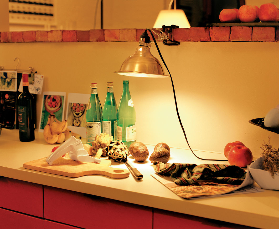 Food preparation in dimly lit kitchen