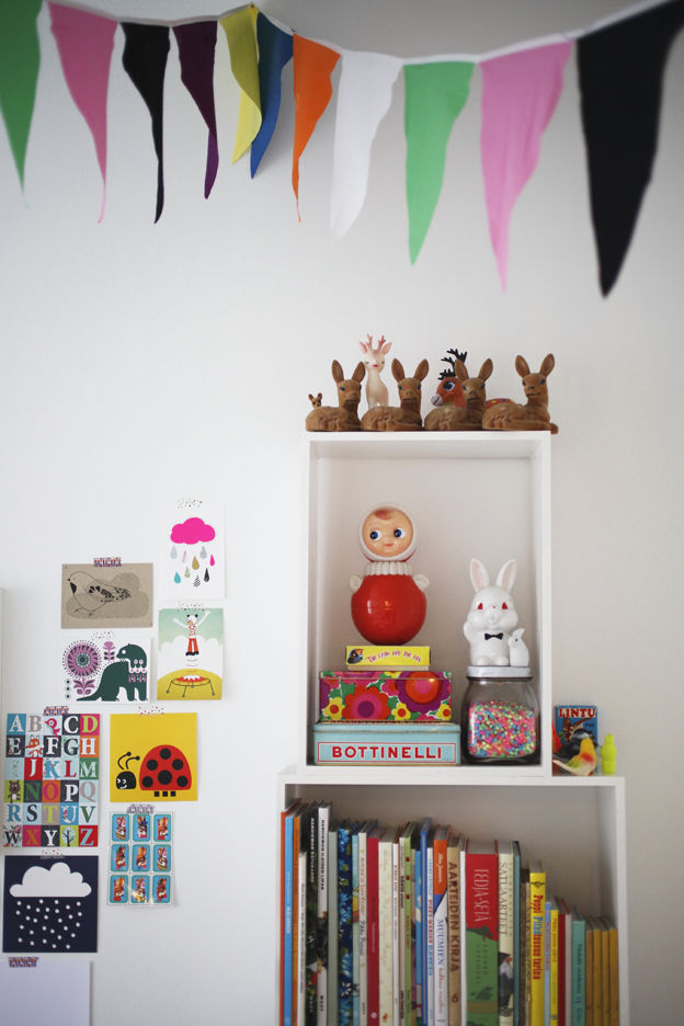 Children's room wall with colorful cotton flag banners