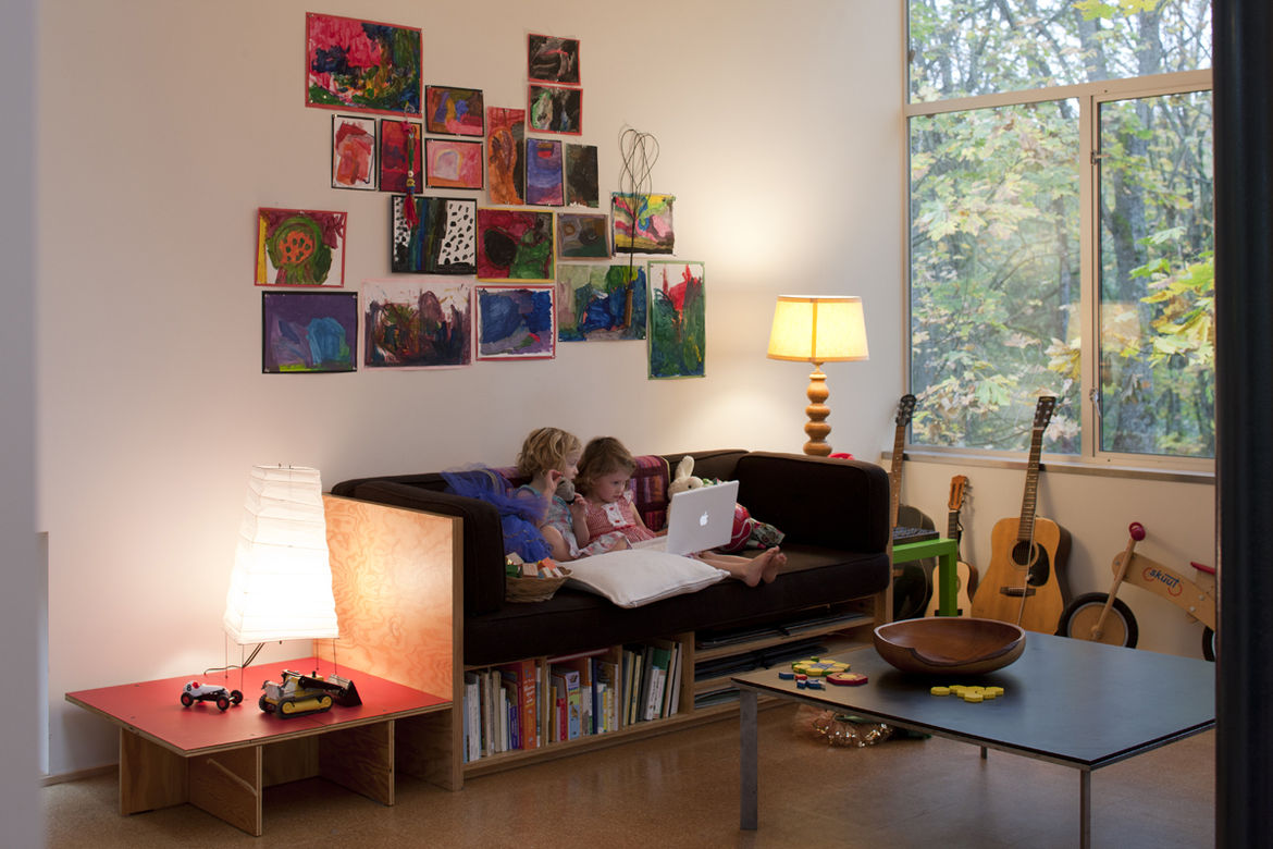 Little girls on laptop in living room with Richlite-topped, steel-base coffee table