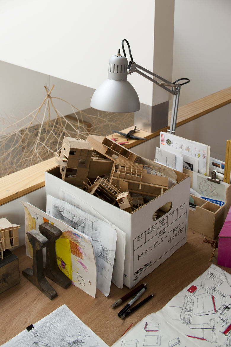 Work desk area with cardboard house models