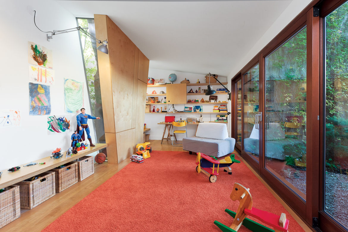 Playroom with red carpeting and wood block window shade