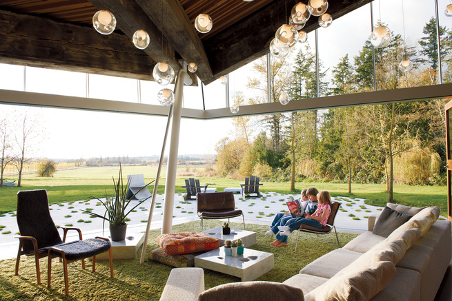 Modern living room with a Canadian hayfield view