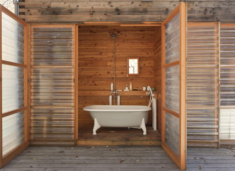 Bathroom with clawfoot tub and fiberglass door