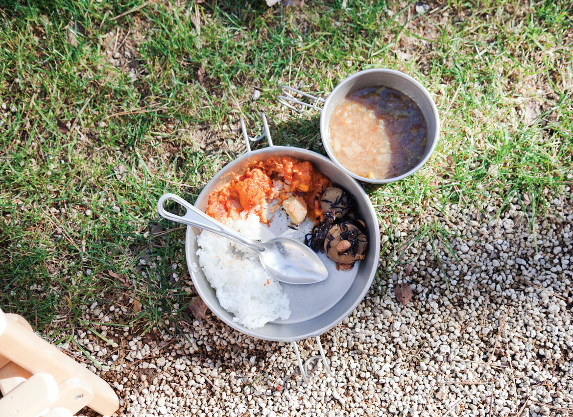 Food served in a traditional camping cookware