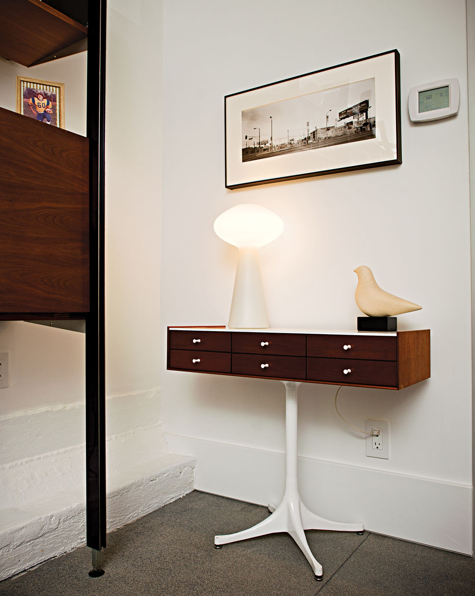 Massimo Vignelli lamp on top of a Nelson jewelry cabinet
