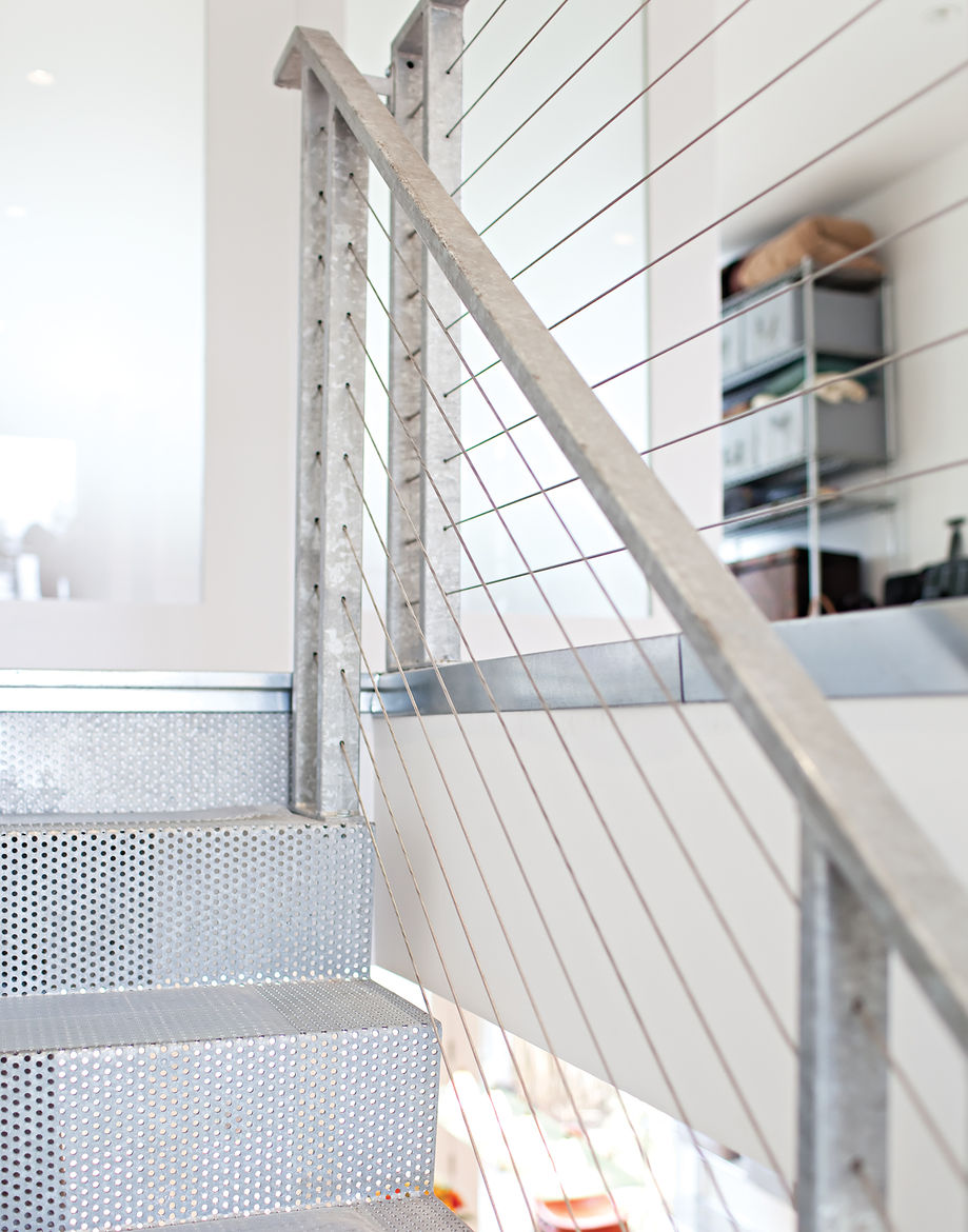 Perforated bent steel plated staircase with galvanized handrails and posts