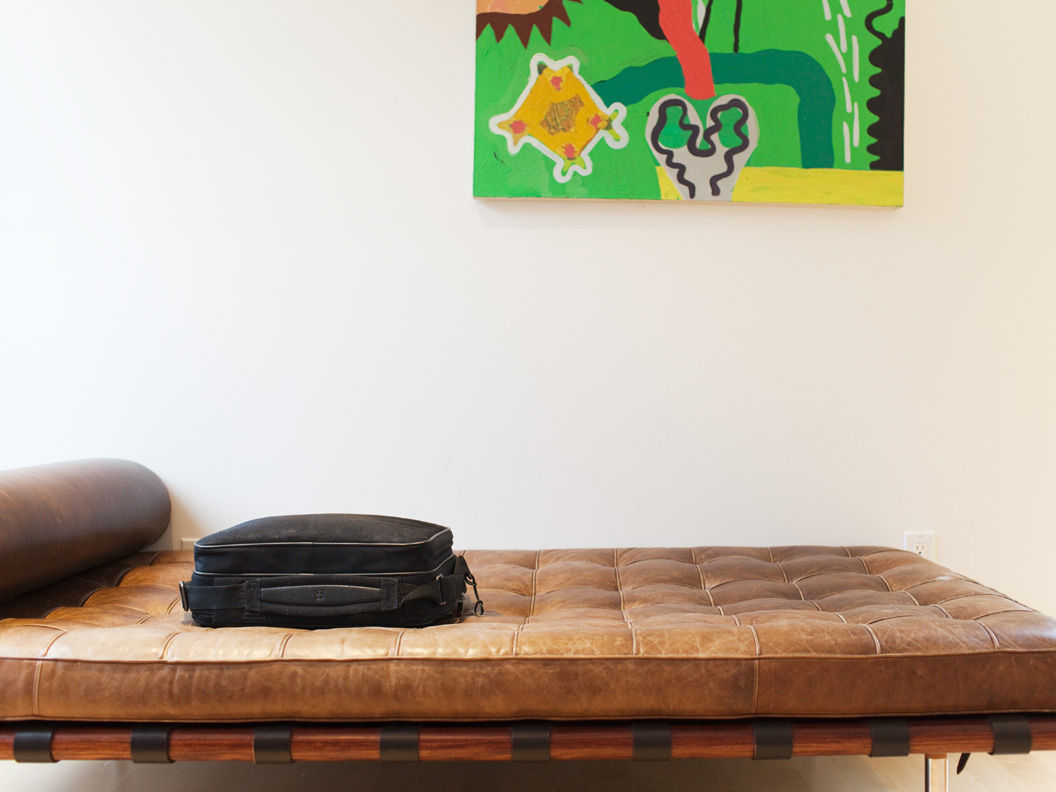 Brown leather weathered Corbusier daybed in the front upstairs loft