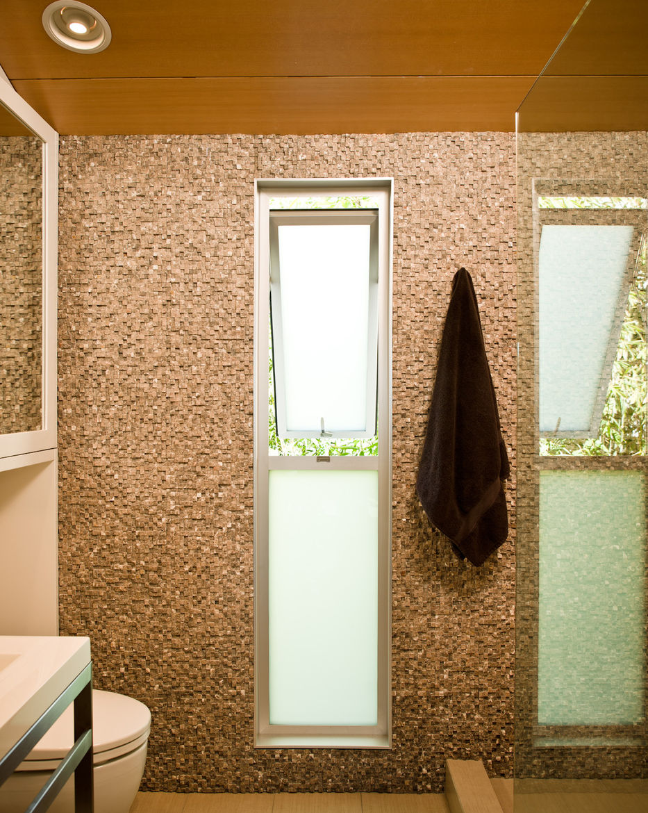 Small shower with tiled wall and freestanding sink from Wetstyle