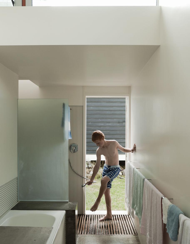 Minimalist indoor shower with wood panel floor