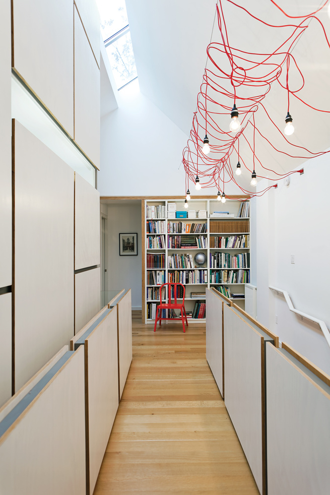 Halllway interior with red cord ceiling light