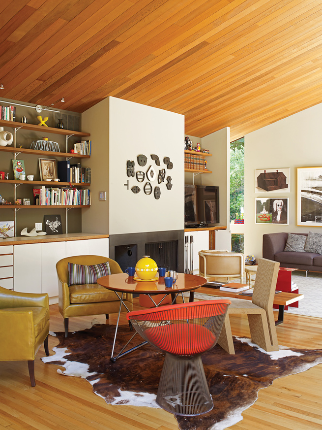Modern living room with redwood ceiling and chairs by Knoll and Vitra