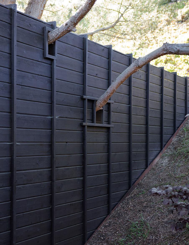 Outdoor charred cedar fence