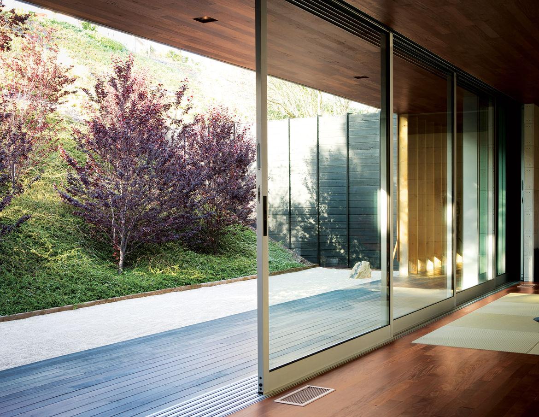 Floor-to-ceiling sliding glass doors in living room