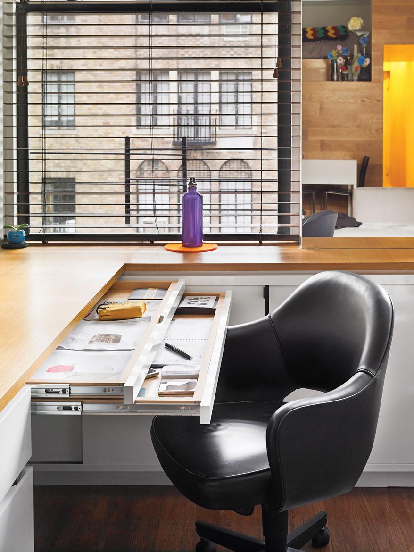 Modern office desk area by window