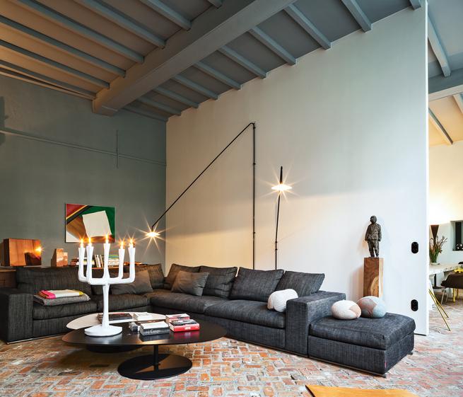 Modern living room with Flexform sofa and Jens Fager candelabra