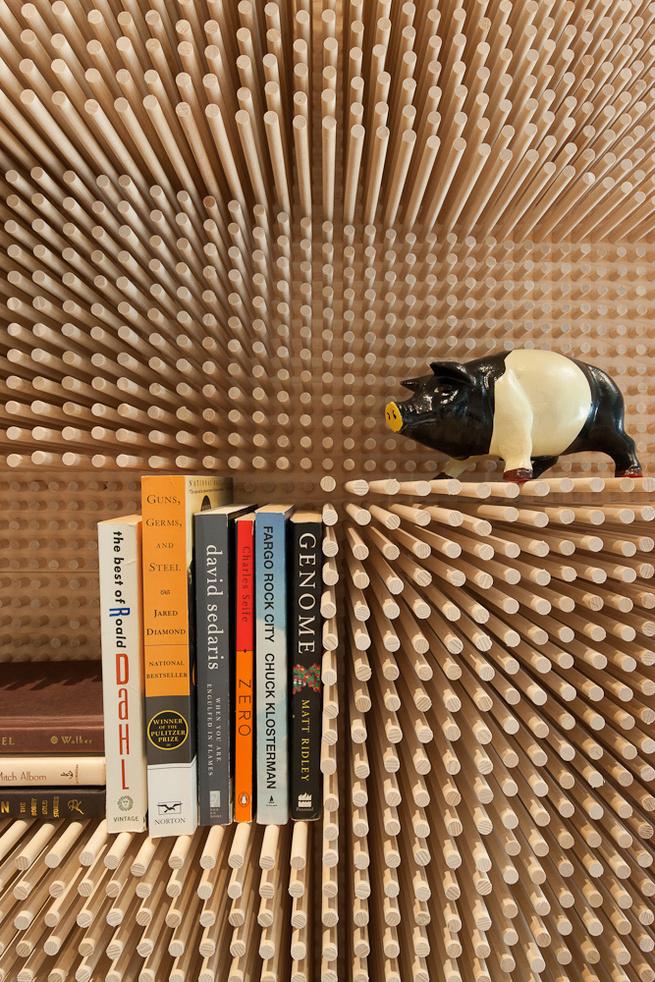 Modern wooden peg board bookshelf