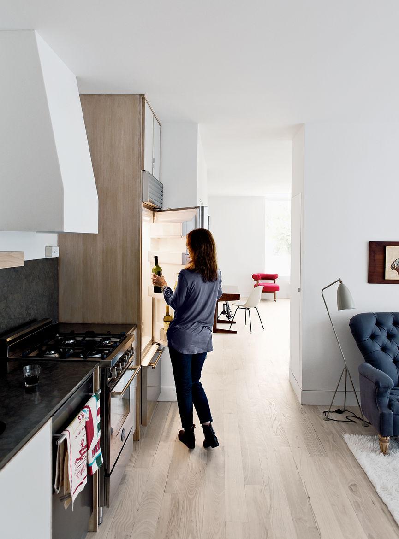 Modern kitchen with Sub-Zero refrigerator and wooden flooring