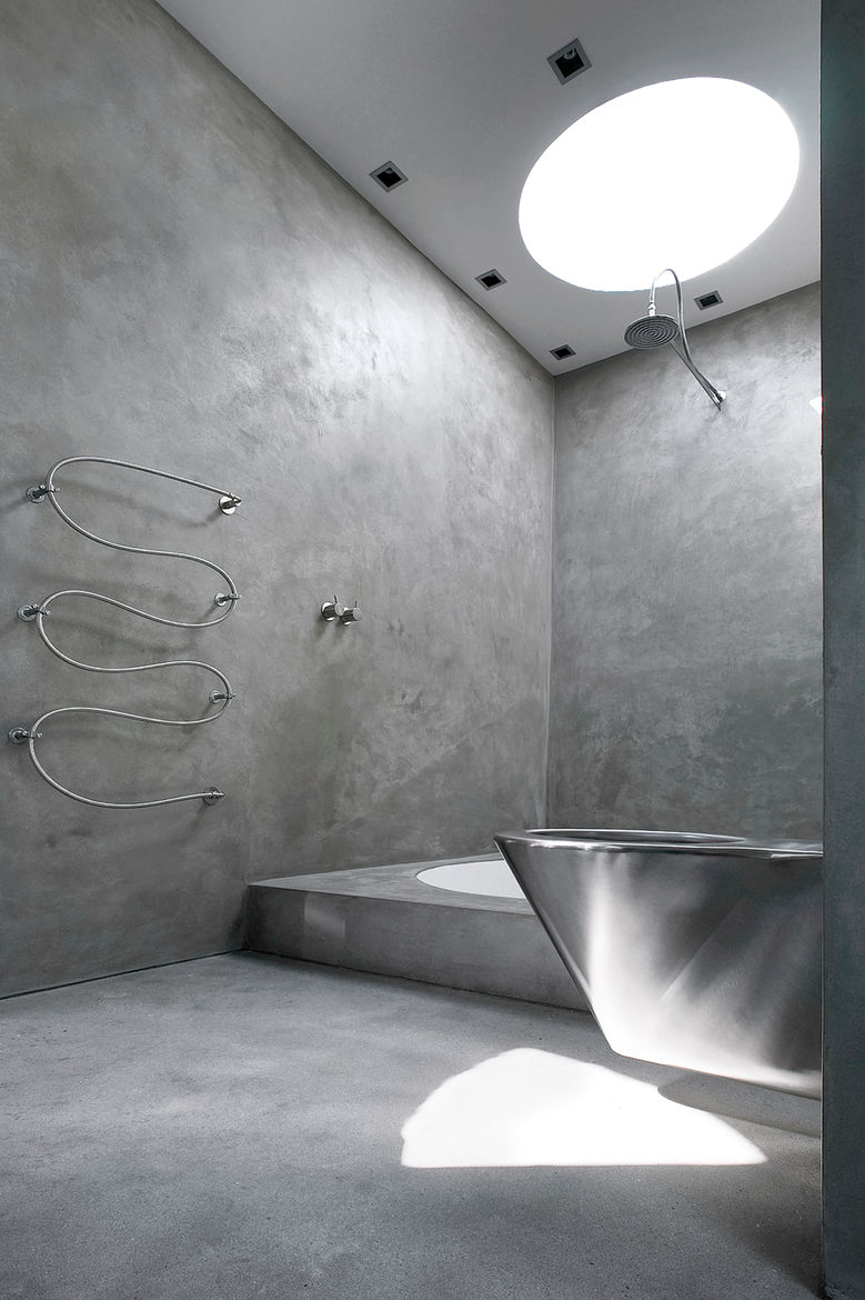 "A Jutland, Denmark, house designed by Mette Nygaard and Morten Schmidt of the architecture firm Schmidt, Hammer & Lassen features a minimalist bathroom that's naturally lit with Plexiglass skylights. <a href=""http://www.dwell.com/articles/cinematic-retrea"