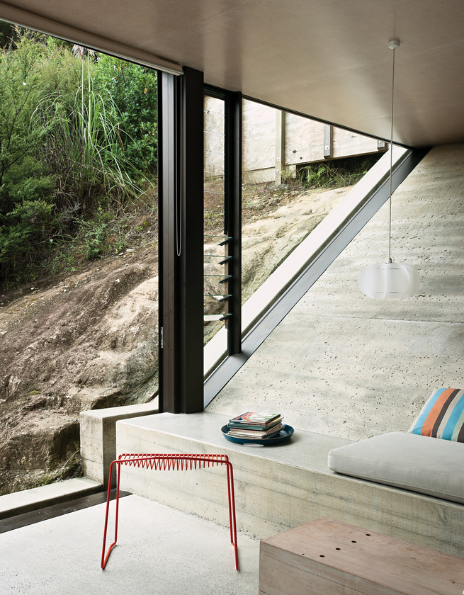 Living room with modern furniture and concrete flooring