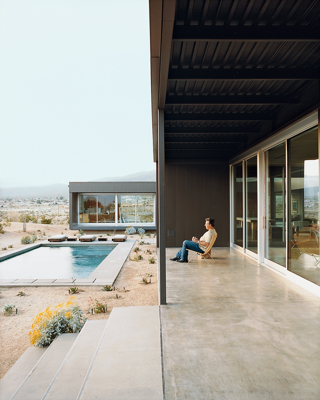 Groupings of succulents accent the home's entry path and pool area.