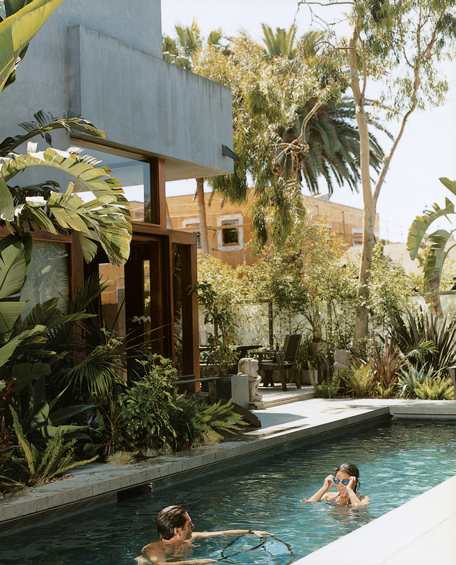 "Sophie and Colin enjoy their new pool, the only non-solar-powered portion of their home in Venice, California, created by their father, architect David Hertz. <a href=""http://www.dwell.com/articles/sustainability-in-stages.html"">Read the full article here"