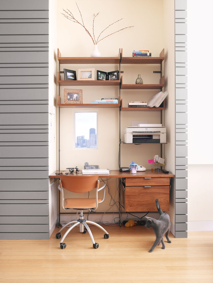 The office cubby, outfitted with a diminutive window (as per Koshkarian's request), is furnished with Atlas shelving.
