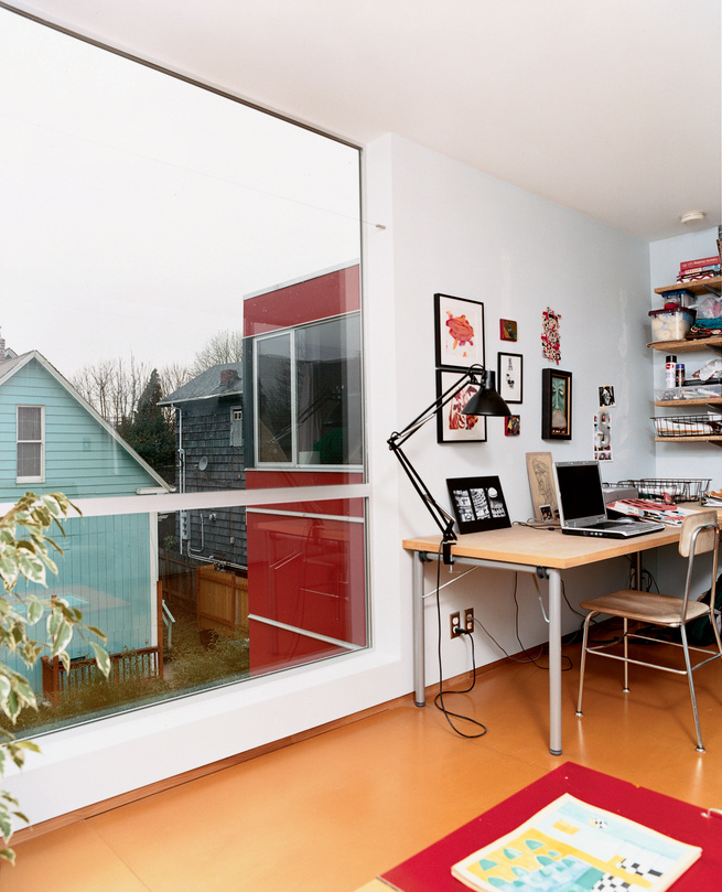 Sarti's upstairs office provides a cozy corner for work and relaxation. The large windows allow him to search the surrounding backyards for inspiration when stuck in a rut.