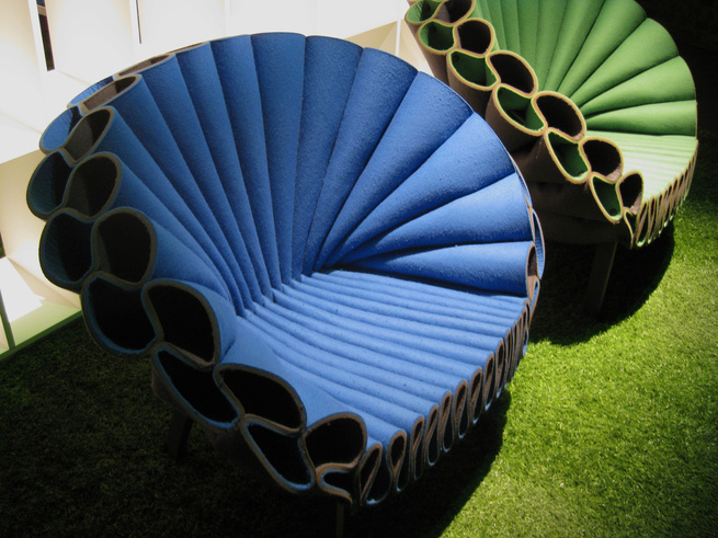 <strong>Peacock Chair by Dror Benshetrit for Cappellini</strong><br /> Colorful industrial weight felt elegantly folded around a simple metal structure forms a fashionable fan to frame all who sit in this new seat.